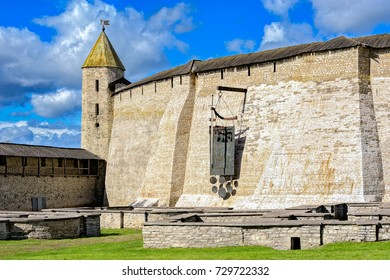Restored huge south fortress wall of Pskov Kremlin - Percy, Dovmont tower and the ruins of temple buildings Dovmont city. Pskov, Russia.