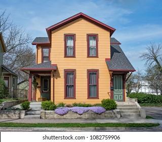 Restored Orange Duplex House with Purple Phlox