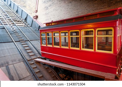 Restored red Duquesne Incline car on the platform of lower station, Pittsburgh