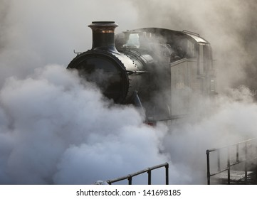Restored steam locomotive steaming at Bewdley Station, Severn Valley Railway, Worcestershire, UK.