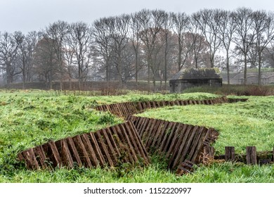 Restored trench with casemate in the background. On publicly accessible grounds in front of Fort Ruigenhoek, part of the New Holland Waterline.