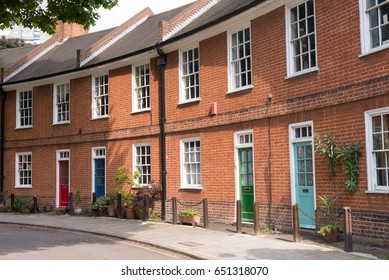 Restored Victorian red brick houses with colored doors in England, UK