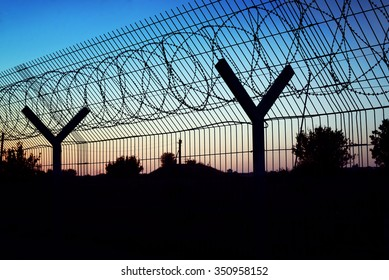 Restricted area - fence with barbed wire.
