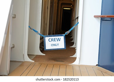 A restricted area on a cruise ship with a Crew Only sign posted