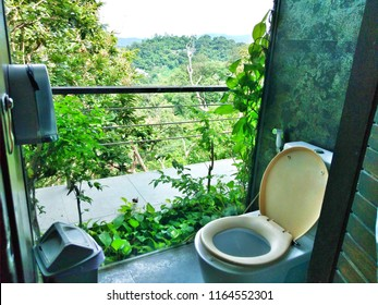 A restroom with beautiful mountain view at khao rang hill, phuket, Thailand. Loo with a good view.