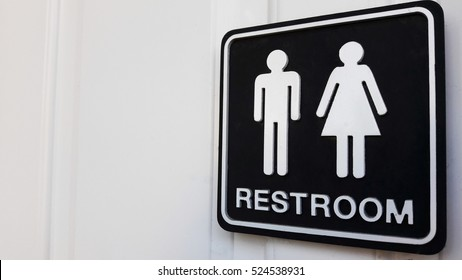 Restroom sign on a toilet door,on white background.