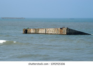 Rests form Mulberry harbour on Goldbay in Arromanches les Bains, Normandy - France from D-day invasion