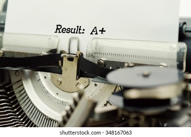Result : A+ - Paper Sheets in Old Vintage Typewriter . Business concept on Toned, Grain Effect, Shallow Depth Of Field and Blurred Background