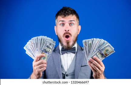 The result surpassed all his hopes. Bearded man holding cash money. Rich businessman with us dollars banknotes. Currency broker with bundle of money. Making money with business. Business startup loan.