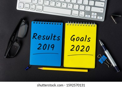 Results 2019 and Goals 2020 - reports and plans on the desktop. Business New Year concept - 2020 is replacing 2019 year