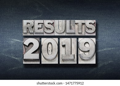 results 2019 phrase made from metallic letterpress on dark jeans background