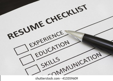 Resume checklist with a pen