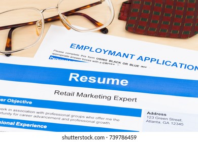 Resume and employment application form with glasses and neck tie