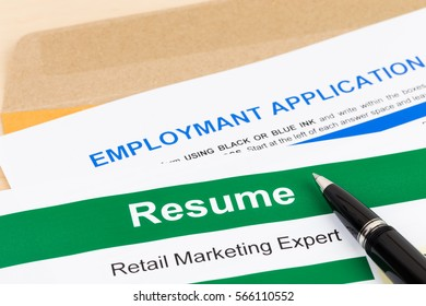 Resume and employment application form with pen