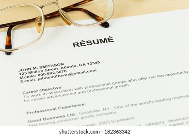 Resume and glasses on table closeup