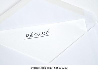 Resume in handwriting in white envelope