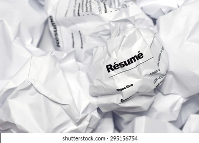 Resume in trash. Picture of resume crumpled up and thrown away in the trash.
