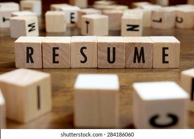 resume word written on wood block