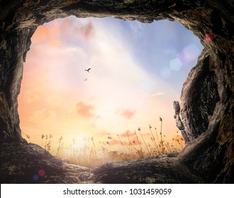 Resurrection of Easter Sunday concept: Tomb stone with meadow sunset background