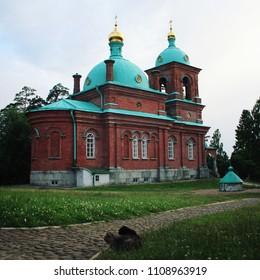 The Resurrection skete near Nikonovsky bay. Toned photo. Island Valaam. Beautiful churches. Voskresensky church. Island of Valaam, Republic of Kareliya, Russia.