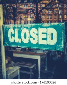 Retail Image Of Grungy Vintage Closed Sign In Furniture Boutique Store