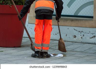 retail of les of man municipal employee with shovel and broom in hand