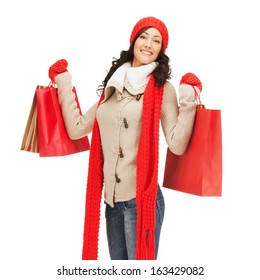 retail and sale concept - full-length picture of happy woman in winter clothes with shopping bags