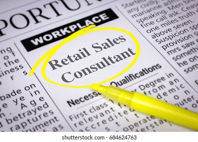 Retail Sales Consultant - Newspaper sheet with ads and job search, circled with yellow marker, Blurred image and selective focus