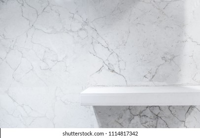 Retail shelf on light marble vintage background. fill objects.