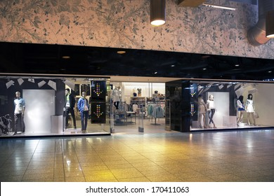 Retail shop entrance or exit. Facade of shop with display. Mannequin, dummy.