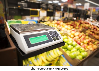 Retail Store Electronic Weighing Scales and the Store Fresh Products in the Background