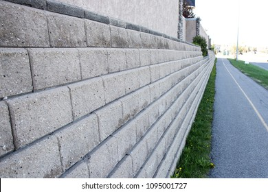 Retaining wall next to pavement on city Street