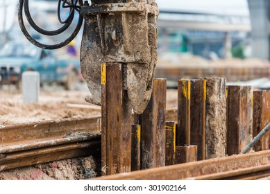 Retaining wall steel sheet pile driving machine work