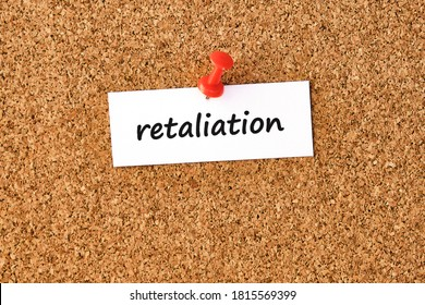 Retaliation. Word written on a piece of paper or note, cork board background.