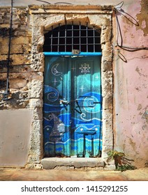 RETHIMNO, GREECE - SEP 06: Beautiful wooden door with marine decoration in shades of blue in old traditional house on September 06, 2018 in Rethymno, Crete island, Southern Greece, Europe.