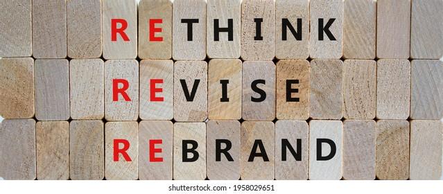 Rethink, revise, rebrand symbol. Wooden blocks with words 'rethink, revise, rebrand'. Beautiful wooden background. Business, rethink, revise, rebrand concept. Copy space.