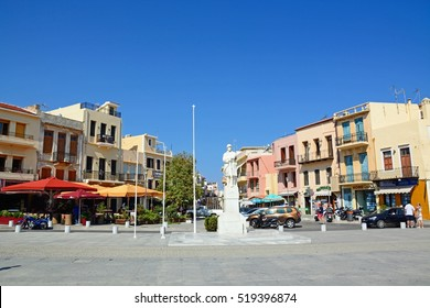 RETHYMNO, CRETE - SEPTEMBER 15, 2016 - Statue to the unknown soldier in Agia Stratiota Square (Agnostou Square) with pavement cafes to the rear, Rethymno, Crete, Greece, Europe, September 15, 2016.