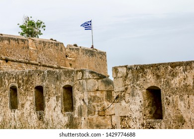 Rethymno. Crete.29 may 2019.The Greek flag flutters on the wall of the Venetian fortress in the city of Rethymno in Greece.
