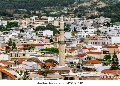 Rethymno. Crete.29 may 2019.Roofs and minaret of a mosque in the old town of Rethymno in Greece.