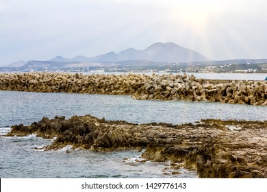 Rethymno. Crete.29 may 2019.View of the entrance to the Harbor and mountains in Rethymno in Greece.