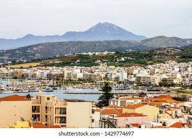 Rethymno. Crete.29 may 2019.View of the promenade and houses against the mountains in Rethymno in Greece.