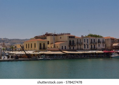 Rethymno, Greece - July  30, 2016: Venetian harbour. The Venetian Harbor, next to the modern harbor of the city, with the Egyptian lighthouse is one of the most picturesque areas of the old town.