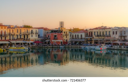 Rethymno, Greece - June 19,2011: People enjoy the sunset at the picturesque water front of Rethymno old town on the island of Crete..