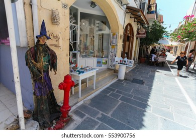 Rethymnon, Island Crete, Greece, - July 1, 2016: The scarecrow near the store on narrow street of Rethymnon (part of Old Town) where there are a lot of small cafes and shops