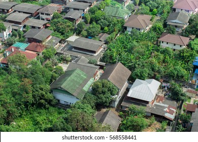 Retire in Thailand and find a cheap and tropical area to live where rents and homes are cheap to purchase.  Rural outskirts district of Bangkok.
