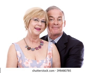 retired couple dressed up on white isolated background