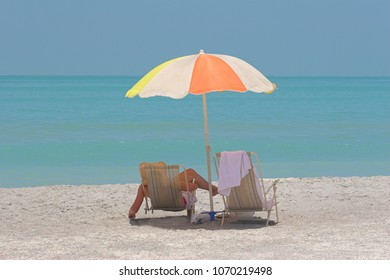 Retired couple enjoying day at ocean side