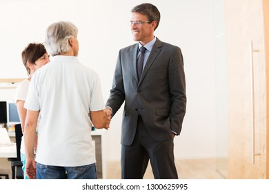 Retired Couple Talking To Their Financial Advisor