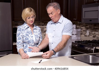 retired couple wearing casual outfits in the kitchen