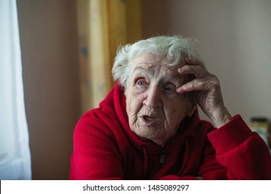 Retired elderly woman says sitting in the house.